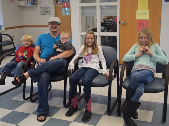 The Greer family waits patiently in the waiting room