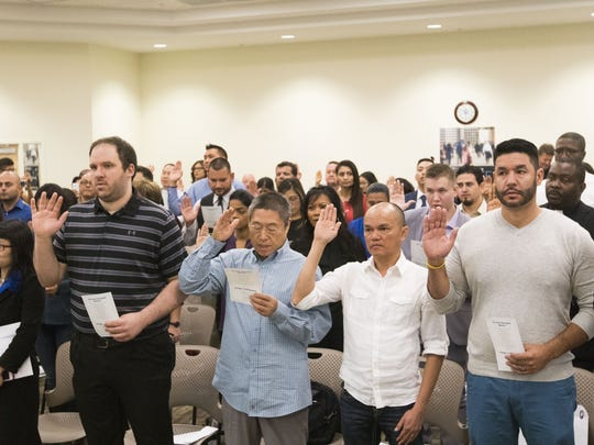 Surrounded by family and friends, the room full of immigrants listened quietly during the president's1 minute, 34-second video message, and then clapped warmly when it was over. They were among the first immigrants to hear Trump's message on Tuesday, Oct. 24, 2017, which debuted inSeptember, more than eight months after Trump took office.