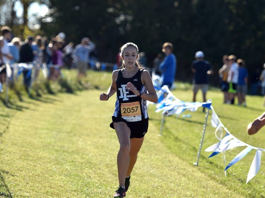 Fort Defiance's Carrie Wright runs toward the finish line of the girls race at the VHSL Valley District Cross Country Championships at Shamrock Farms in Verona, Va., on Tuesday, Oct. 24, 2017.