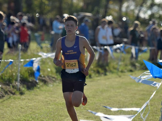 Waynesboro's Sam Sikora races toward the finish line during the boys race at the VHSL Valley District Cross Country Championships at Shamrock Farms in Verona, Va., on Tuesday, Oct. 24, 2017.