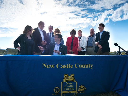 New Castle County Executive Matt Meyer and guests gather at a press conference and signing held Wednesday afternoon announcing that New Castle County will create new rules to allow large scale solar farms in the county and a company wants to put one near Middletown.