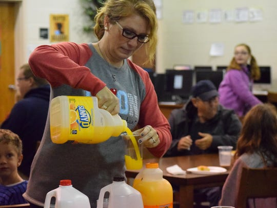Jacqi Teehan offers her time to serve milk and orange juice  to the 'dudes' in attendance.