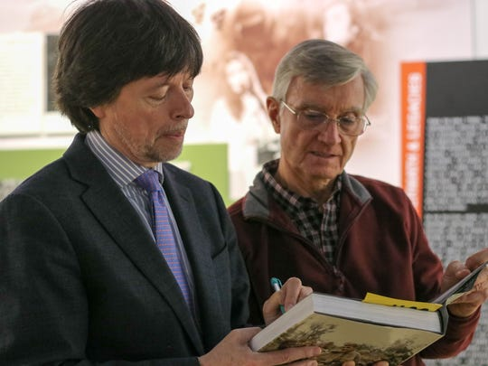 Award winning filmmaker Ken Burns, left, autographs a book for Vietnam veteran Rick Geffken, at the Vietnam Era Museum at the New Jersey Vietnam Veterans Memorial in Holmdel on Oct. 27, 2017.