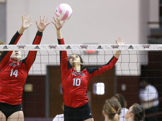 Brandon's Katherine Bass (14) and Brandon's Alexxa Haggerty (10) try to block a shot during the the MHSAA Class III Volleyball Championships on Saturday, October 28, 2017 at the Newell-Grissom Building on the campus of Mississippi State University in Starkville. Brandon coach Kelsa Walker opposed a proposal that suggested making volleyball a spring sport and fast-pitch softball a fall sport. Photo by Keith Warren