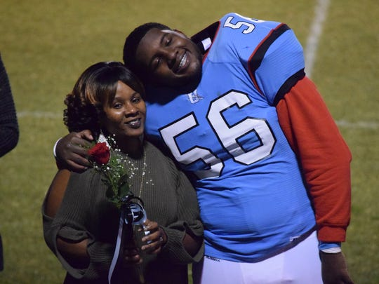 Marqualio King smiles with his mother, Soccoro McGuire during the senior night ceremony last Friday night.