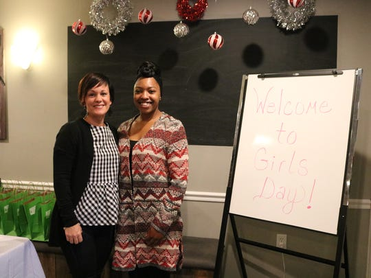 Carrie Harmon and Ladazsa David stand ready to welcome guests to the Girls Day event.