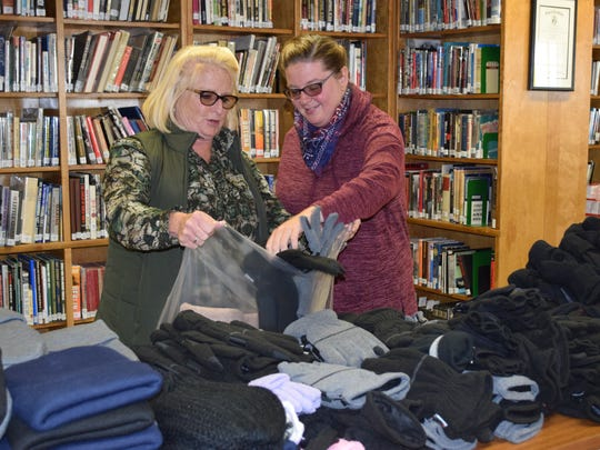 Cheryl and Sarah Crescitelli of Franklin Township fill Blessings Bags with hats, gloves and socks