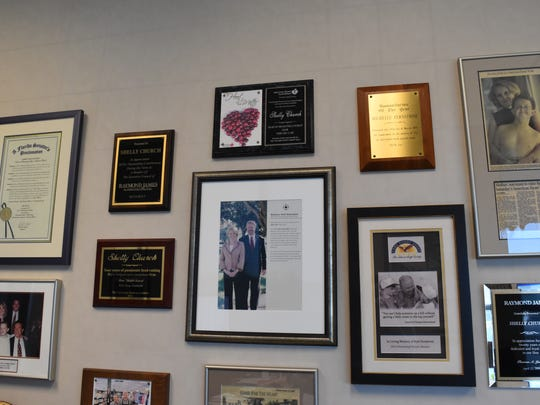 Shelly Church has one wall of her office filled dozens of plaques, photos and mementos of her and late son Kyle's work with the American Heart Association. Church has made it her mission to raise money for the Collier County Heart Walk and this year reached a million-dollar milestone.