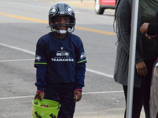 MJ Patterson smiles as Russel Wilson of the Seattle Seahawks.