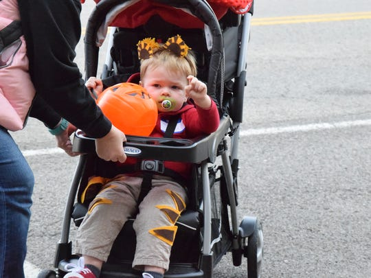 Luke Franklin eyes some candy while trick-or-treating.