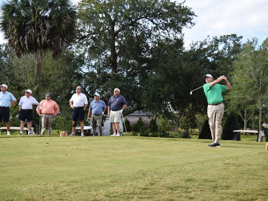 Pensacola's Jerry Pate hits a tee shot during the 44th annual Jerry Pate Boy Scout Invitational at Pensacola Country Club to help raise money for the local Boy Scout chapter.