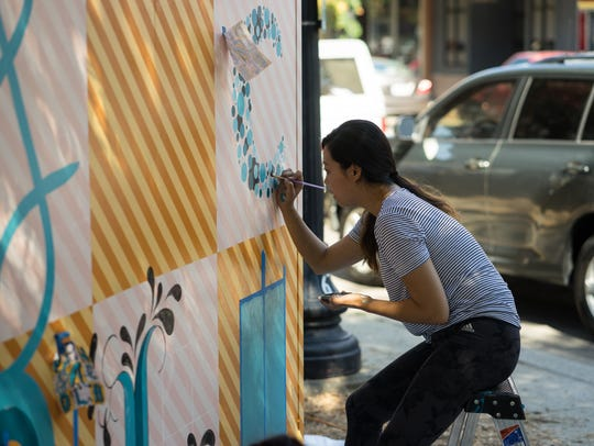 """CUBED kicked off with the artists convening at the Martin Luther King Jr. Plaza for a """"live mural performance."""""""