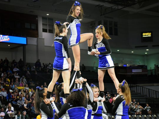 Fort Defiance's competition cheer team performs its routine during the preliminary round of the VHSL Class 3 Cheer Championships at the Siegel Center in Richmond, Va., on Saturday, Nov. 4, 2017.