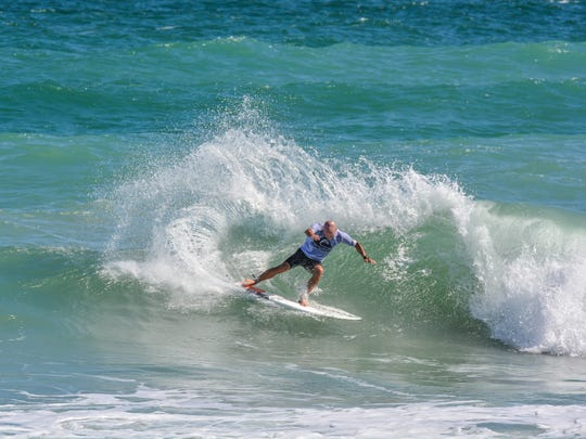David Speir, 46, was the oldest competitor in the King of the Peak surf contest Nov. 5 in Sebastian Inlet. Speir won the competition in 2000.