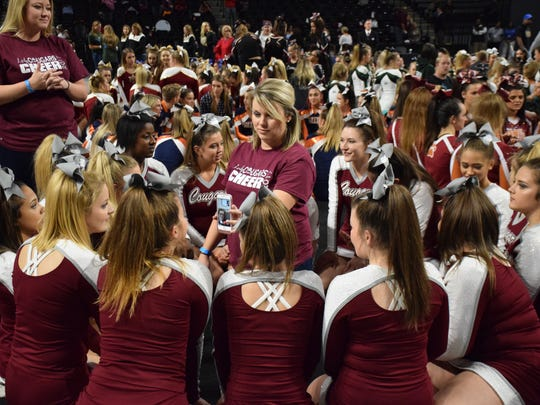Tammy Carter, head coach of Stuarts Draft's competition cheer team, share a FaceTime call with assistant coach Brittany Orr, who is at home after giving birth to a son, while the team waited for results from the Class 2 final at the VHSL Cheer Championships on Saturday, Nov. 4, 2017, at the Siegel Center in Richmond, Va. The Cougars won the state title.