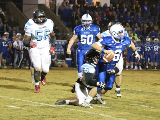 Ross Hicks takes down his LaRue Co. opponent during the game.