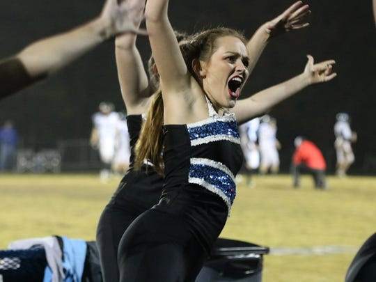Emily Greenwell shouts during the dance at the LaRue Co. game.