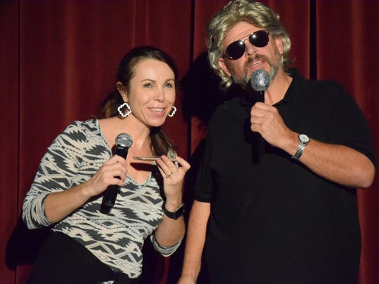 Malinda Beauchamp and John McCollum act as emcees during a practice held earlier this week.
