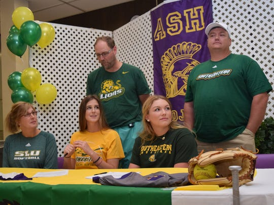 ASH softball players Caroline Manzer (center, front)