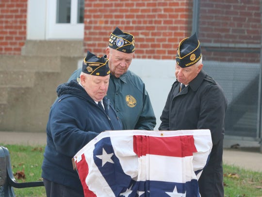Veterans George Blakeley, Eddie Collins, and Don Gill prepare for the veterans program.