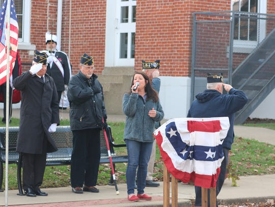 Andria Lyon sings the national anthem during the Veterans