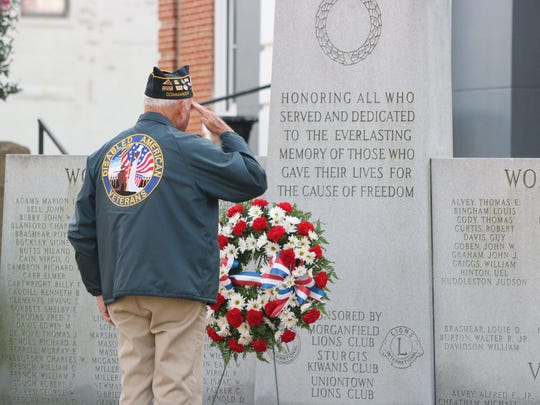 Veteran Eddie Collins salutes the Wreath of Honor to