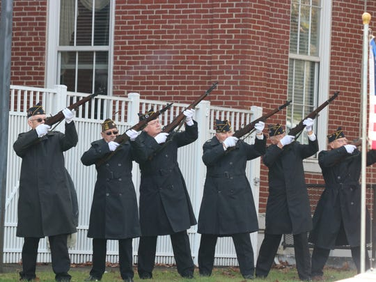 The Honor Guard performs the 21-gun salute in honor
