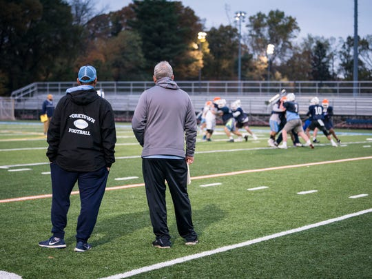Gene Posati, left, and Bruce Hanson of Yorktown High School in Arlington, Va., have combined for 100 years of high school coaching experience and say recent changes to the game are for the best.