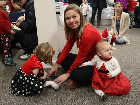 Lake Country Bed Barn owner Elise Miller and daughters Quinn, 3, and Mira, 1, make ornaments during Story Time with Santa at Lake Country Bed Barn, 1560 Moreland Blvd., Waukesha.