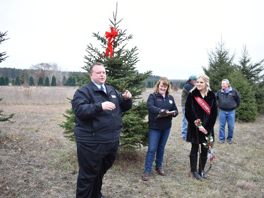 72nd Assembly District Rep. Scott Krug speaks during the tree cutting ceremony at Ginter Tree Farms on Nov. 14.