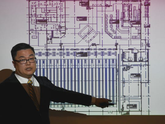 Chief Executive Officer of Downtown Venture Corporation Jay Chun presents his business plan for Basin Lanes to City Commissioners in November.