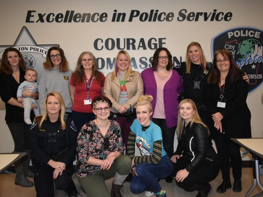 Female employees of the Appleton Police Department are adding purple hair extensions as part of an effort to raise money for charity.