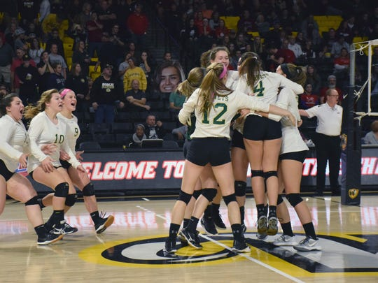 Members of Wilson Memorial's volleyball team gather together after winning the VHSL Class 2 volleyball championship with a five-set victory over Radford on Saturday at the Siegel Center in Richmond.