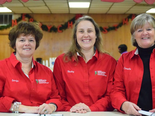Sonya Dalyrample, Becky Bacon, and Carol Cowan smile as they work the open house event at Danhauer's.