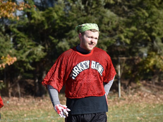 Benjamin Conlon is one of several people who participates in an annual pickup football game in Ridgewood, which has been a tradition for 50 years.