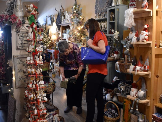 Customers shop for Christmas presents at Victoria during Small Business Saturday.