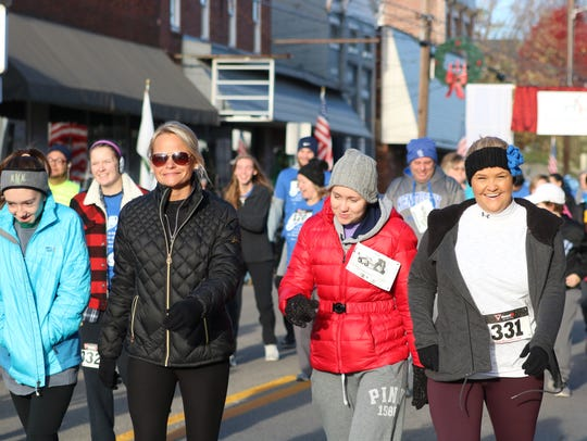 A group of local women begin the race during the 5K.