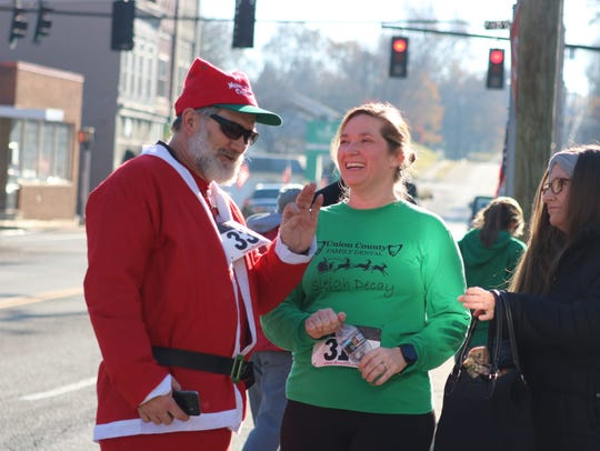 Jerry Padgett dressed as Santa talks with Laura Hancock