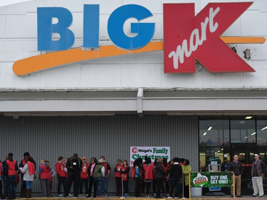 Volunteers gather outside Kmart for the Weigel's Family