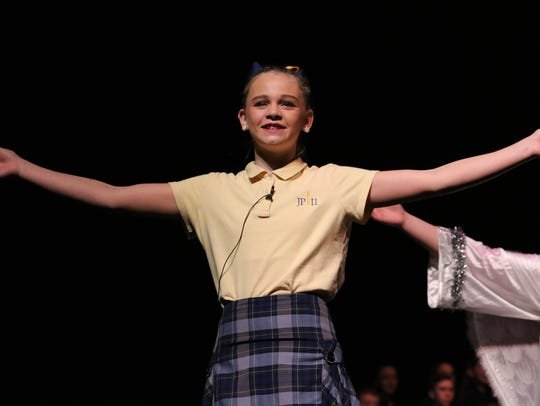 Emma Simms dances to the music during the play.