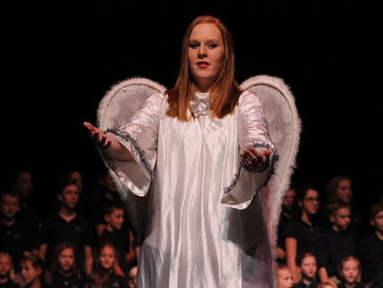 Lauren Clements acts as the angel Michael.
