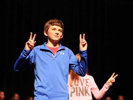 Caleb Tripp performs in a dance during the play.