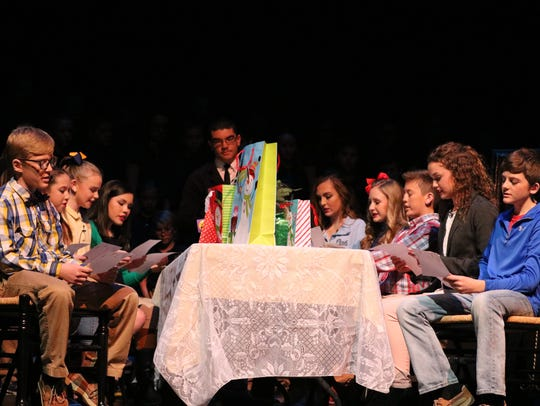 "The students sit at the table to figure out what the ""gift of Christmas"" is during the play.  Included in photo: Trayce Eckman, Gracie Gough, Emma Simms, Sydney Brown, Elijah Price, Jillian Hagedorn, Ella Beasley, David Kramer, Ainsley Beaven, Caleb Tripp."