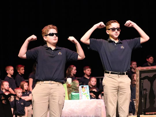 Walker Farmer and Collin Nalley perform a dance for the Christmas play.