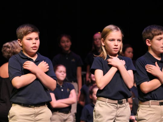 Elijah Brown, Lauren Lovell, Coy Divine use dance moves to express the meaning of Christmas.