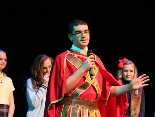 Elijah Price speaks to his friends on stage during the play.