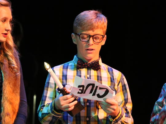 """Trayce Eckman reads off a """"clue"""" about the gift of Christmas."""