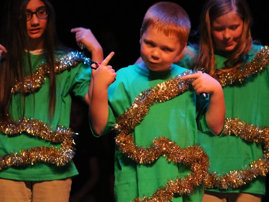 Zachary Lyon dances to a song during the Christmas play.