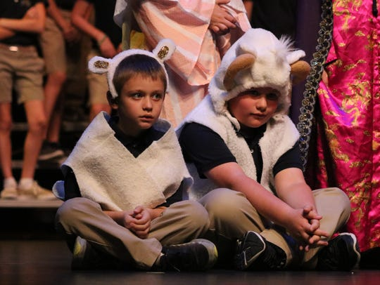 Kooper Vessels and Ryan Thomas perform as sheep at the manger.