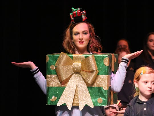 Jillian Hagedorn dresses as the gift during the Christmas play.